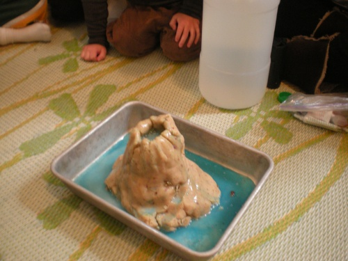 This year we made our volcano with left over rose bud play dough and blue lava, kid's choice!