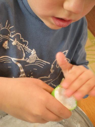 Pressing mixture into a plastic egg.